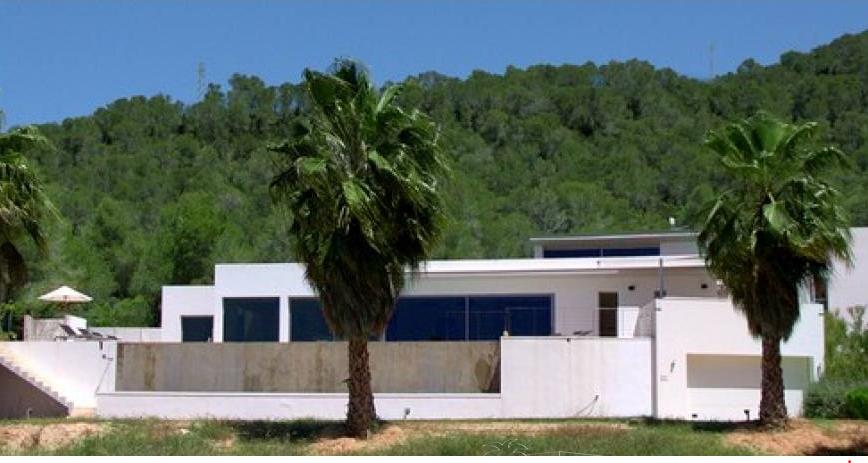 Modern villa in Cala Tarida with panoramic sea views
