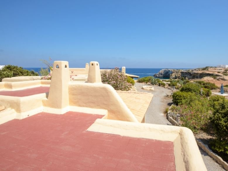 Rarity on Ibiza in sale - 2 houses first line to the sea