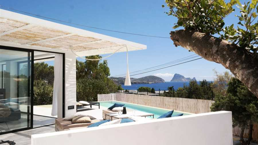 Modern house overlooking Es Vedra and sun set