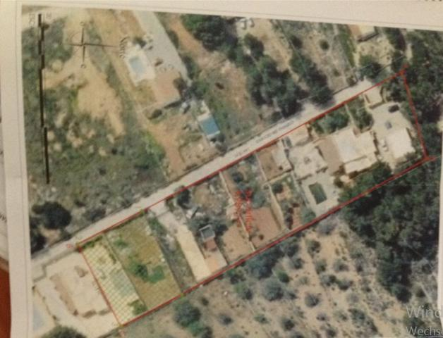 Plot in Es Cubells of 4.989 mts2 with two houses expandable to 1000 m2