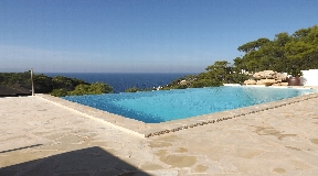 Amazing front line villa in Cala Vadella with sunset in front of the house