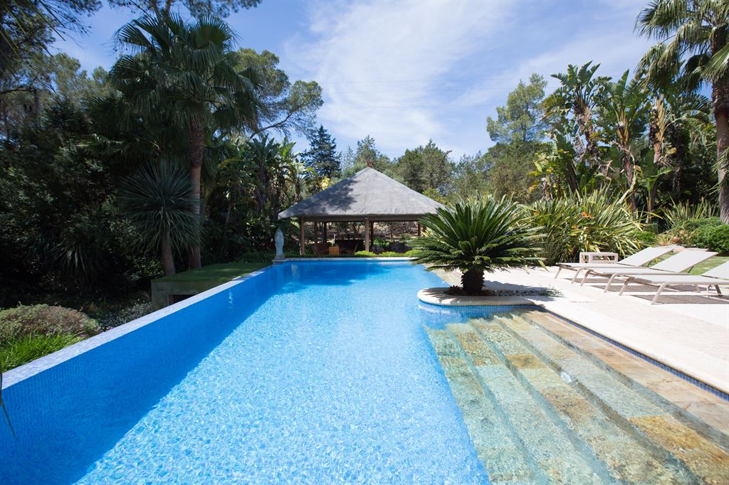 Paradisiacal villa surrounded by a tropical garden near Santa Eulalia