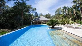 Paradisiacal villa surrounded by a tropical garden near Santa Eulalia