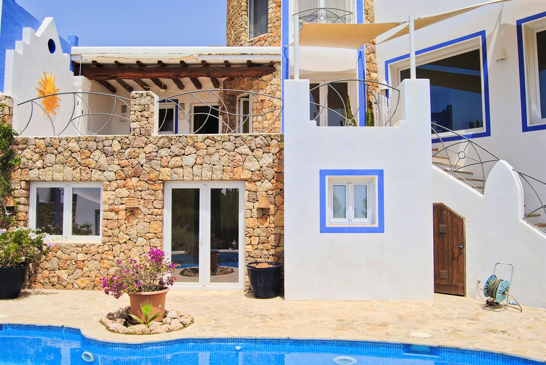 Delightful townhouse with tower very close to the centre of Santa Eulalia offering nice sea views