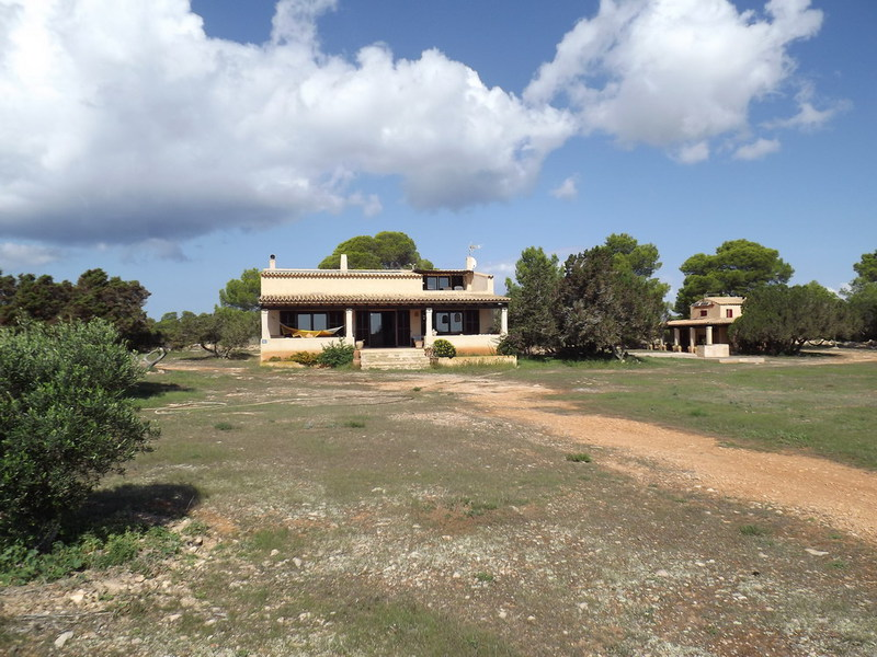 Huge land with two villas in Es Cap de Barbaria for sale