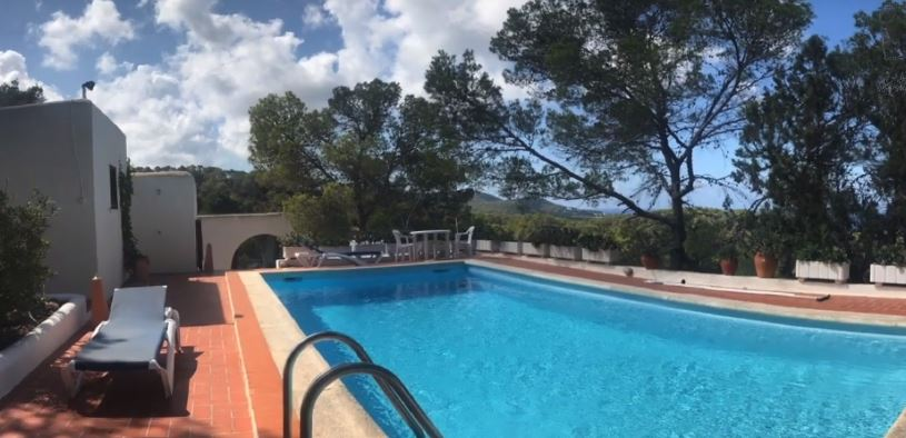 House with pool for sale in Cala Tarida with sunset view to the sea