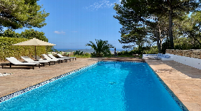 Modern luxury villa high on hill overlooking Ibiza town